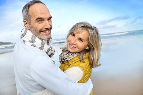 Happy older couple on beach