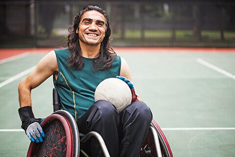 Athlete in wheelchair on tennis court