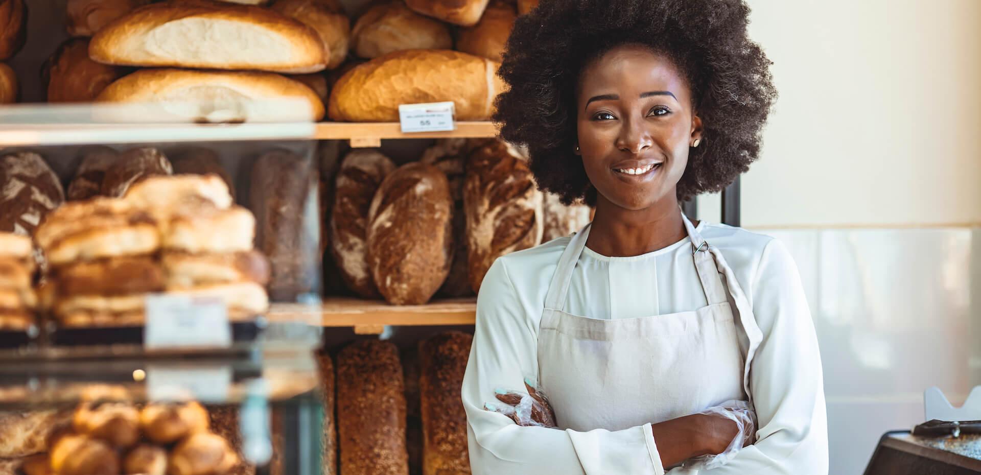 Confident African American baker posing in her bakery